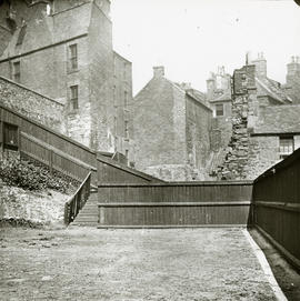 View of backcourt garden, wooden fence and steps
