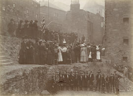 Photograph of group of people inside West Port Garden, Edinburgh
