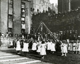 View of West Port Garden, girls dancing around maypole
