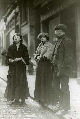 Street scene, two women and a man