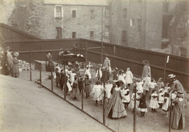 Group of children and women playing in a garden, probably not West Port Garden, Edinburgh